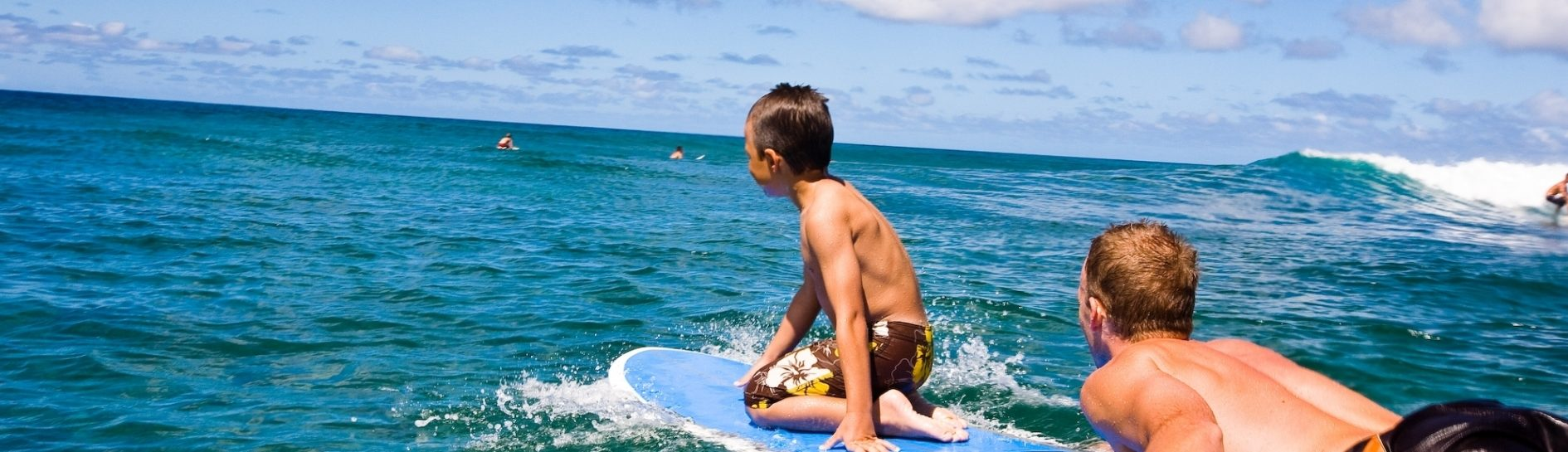 Hawaii vacation surfing boys