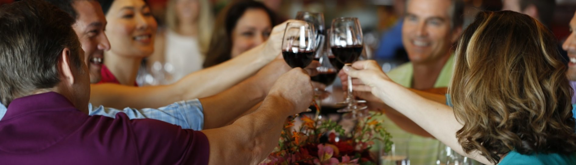 group of millennial travelers toasting with wine
