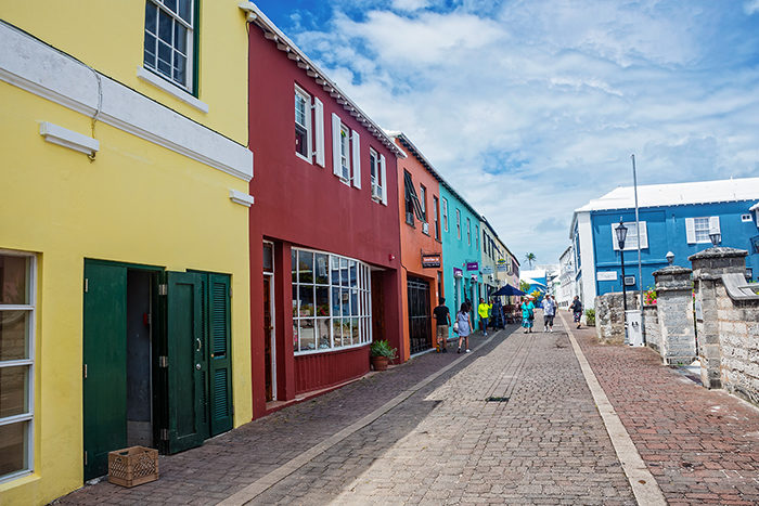 St George's, Bermuda - May 27,2016: A narrow street and colorful shops are typical of St. George's a popular tourist location in Bermuda.