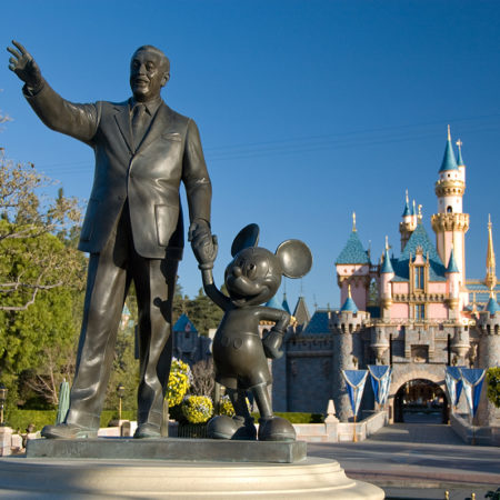 Walt Disney and Mickey Mouse at entrance to Disneyland