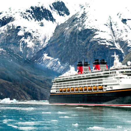 In 2017, Disney Cruise Line guests set sail to Alaska's Icy Strait Point on new itineraries departing from Vancouver, British Columbia. Pictured here, the Disney Wonder sails through Alaska's Tracy Arm Fjord. (Kent Phillips, photographer)