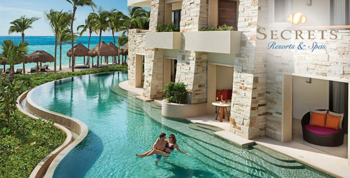 A couple relaxes in luxury room-side pool