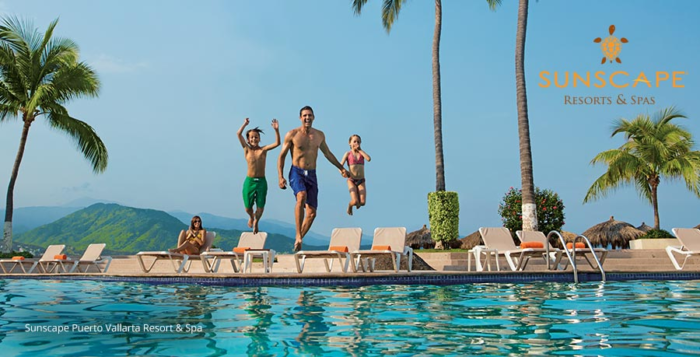 Family jumps into a luxury resort pool
